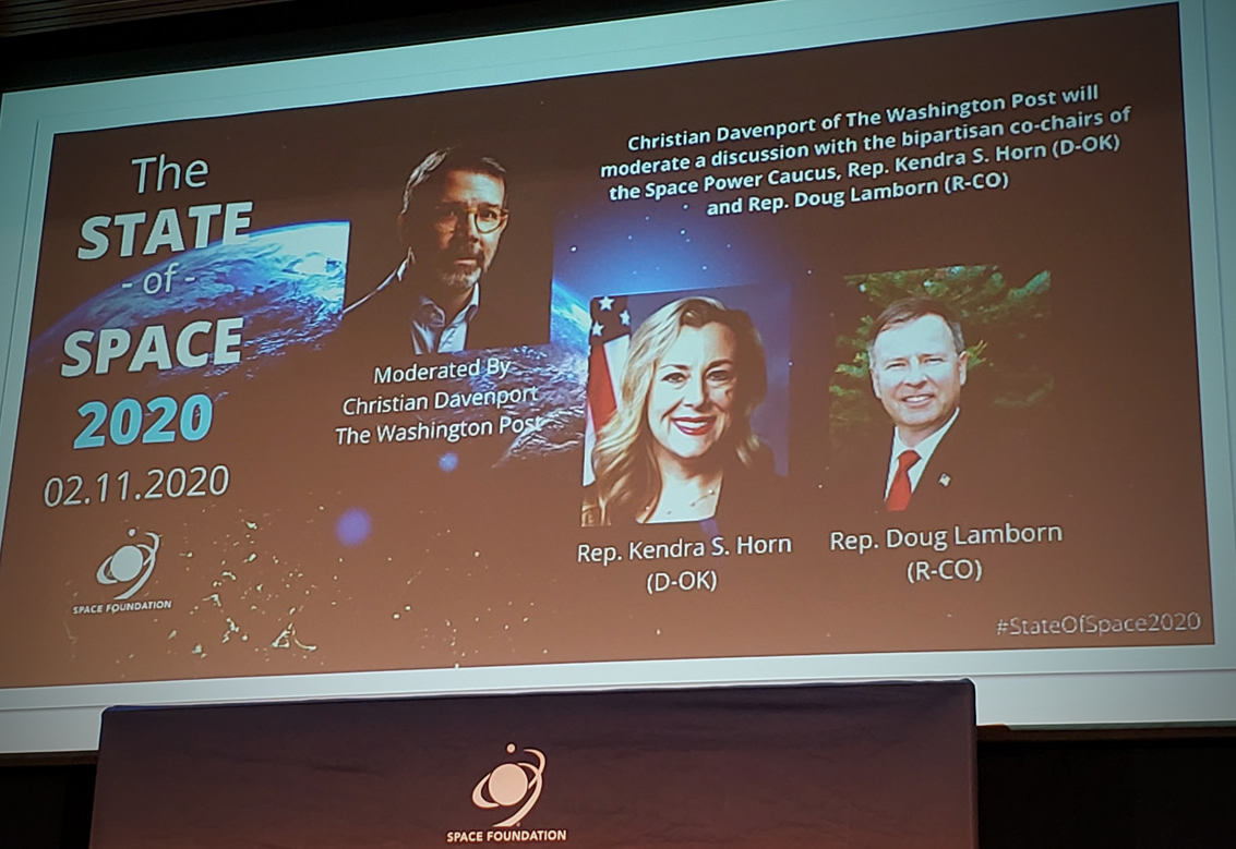 A projected screen highlighting members of the Congressional panel