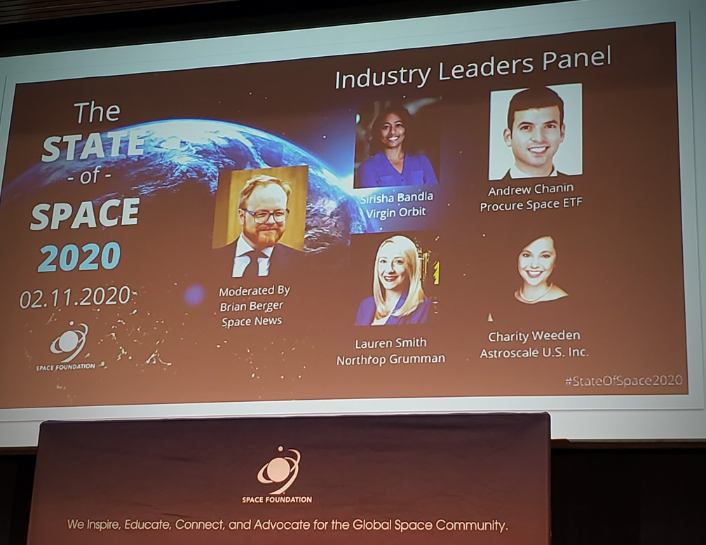 A projected screen highlighting members of the industry panel