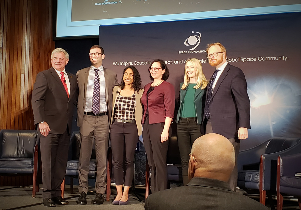A group photo of the industry panel members with the Space Foundation CEO