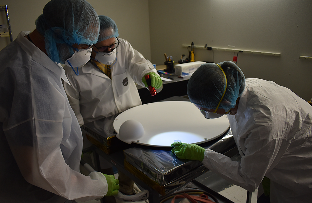 The install team inspects the Acusil mold. Courtesy Peraton.