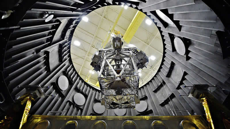 The Optical Telescope Element Simulator, being lowered into the Space Environment Simulator vacuum chamber via crane to be tested to withstand the cold temperatures of space.